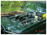 In the summer of 2006 CO Pat MacManus was patrolling the Allegan Game area and heard some shooting. Curious about what might be going on, he stopped and found four boys, 16-14-14-13, with all of these weapons and 3,000 rounds of ammo. They had skipped school for the day to do a little shooting. The boys were all cooperative. The AK-47 had been bought off the street in Grand Rapids for $400, which one of the boys had gotten for Chrismas. All the parents were called and came to fetch their young men, and one might say they were NOT happy with the boys.